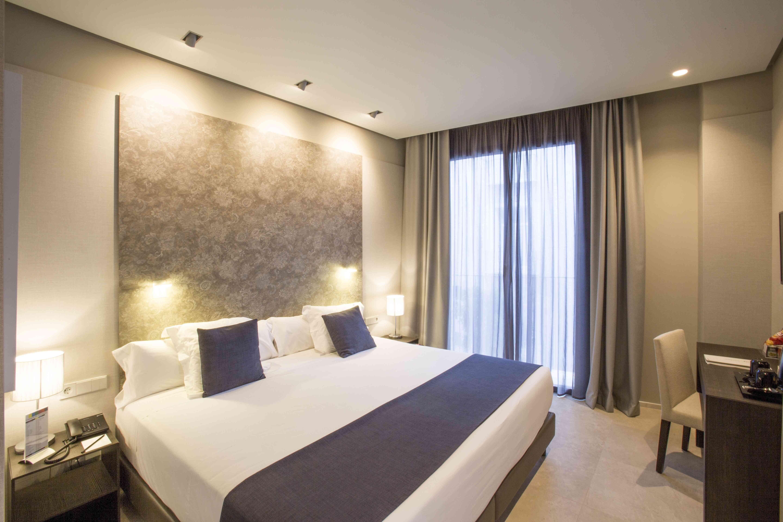 Habitaciones hotel vincci mercat web oficial for Habitaciones familiares valencia